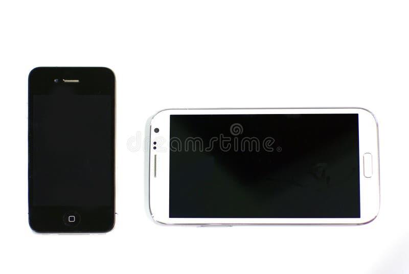 Twee slimme telefoons op geïsoleerde achtergrond stock foto