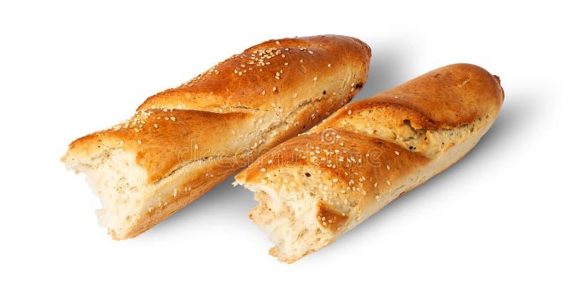 Twee stukken van Franse baguette naast stock fotografie