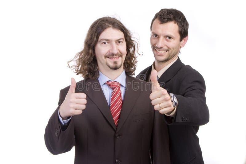 Twee succesvolle bedrijfsmensen met omhoog duim stock fotografie