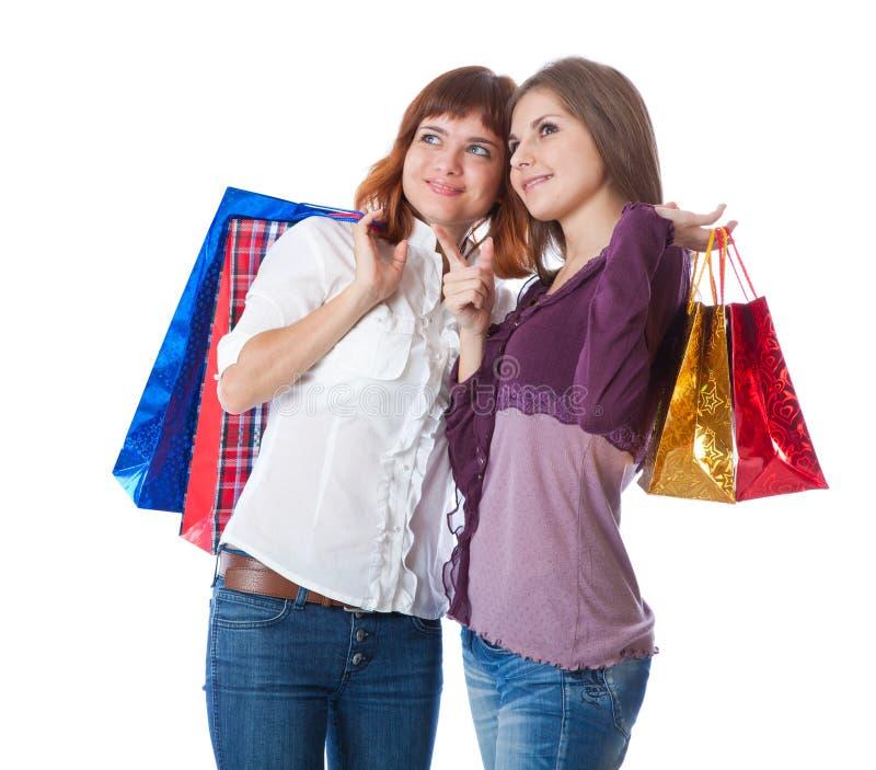 Twee tienermeisjes met zakken stock afbeelding