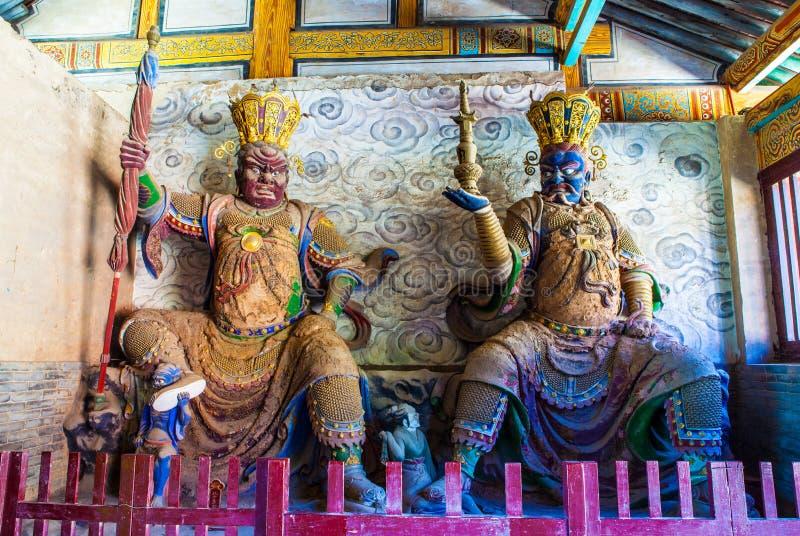 Twee van vier Boeddhistische koning-Virudhaka en Dhrtarastra in Tianlongshan van Tai-Yuan stock foto's