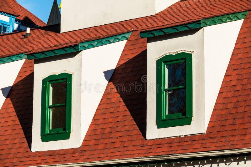 Twee vensters op zolder royalty-vrije stock afbeeldingen