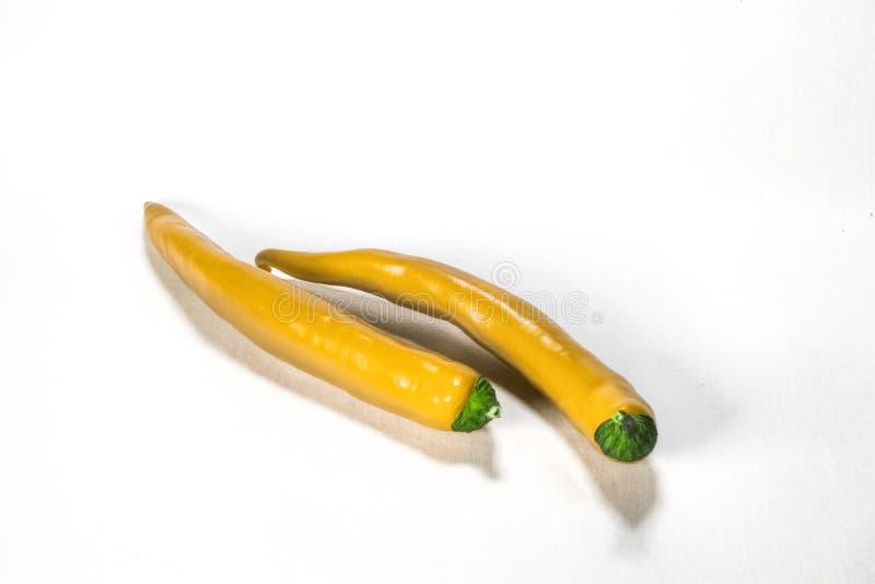 Twee Verse Gele Chilis op een witte Achtergrond royalty-vrije stock foto