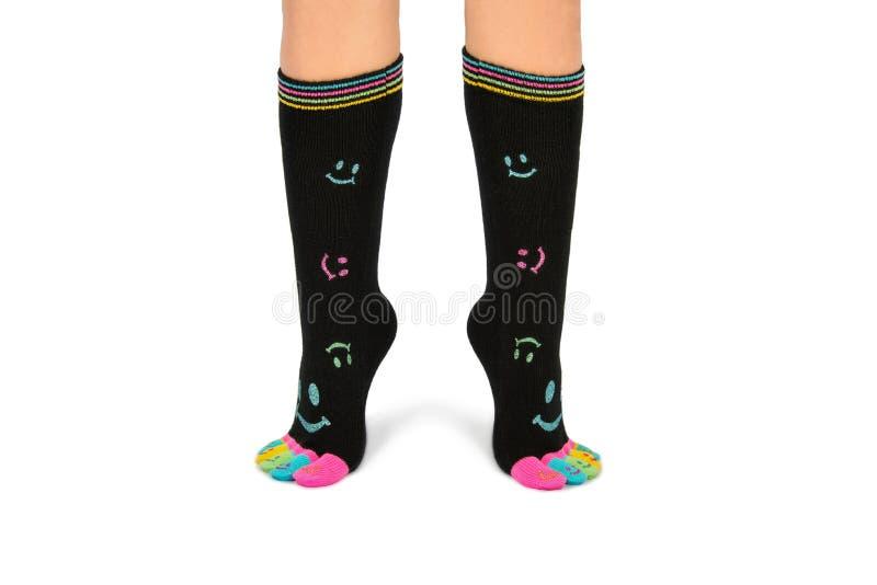 Twee voet in gelukkige sokken met tenen royalty-vrije stock afbeelding