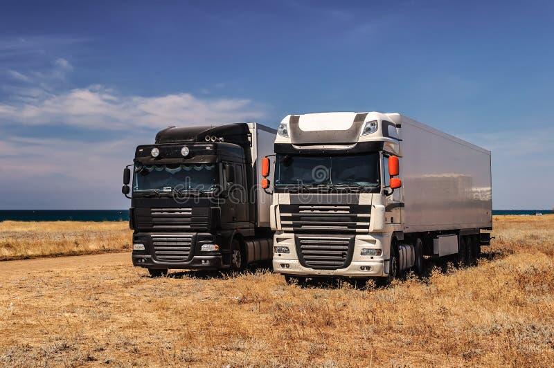 Twee Vrachtwagens royalty-vrije stock afbeeldingen