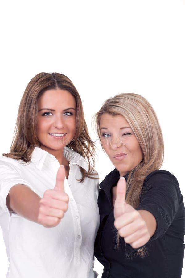 Twee vrouw geven duimen op gebaar royalty-vrije stock afbeelding