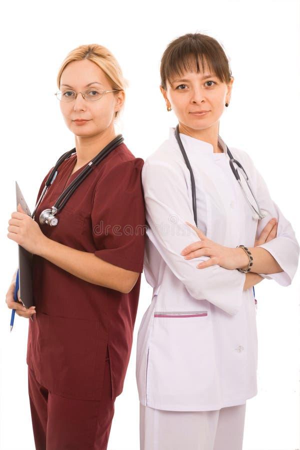 Twee vrouwelijke artsen stock afbeeldingen