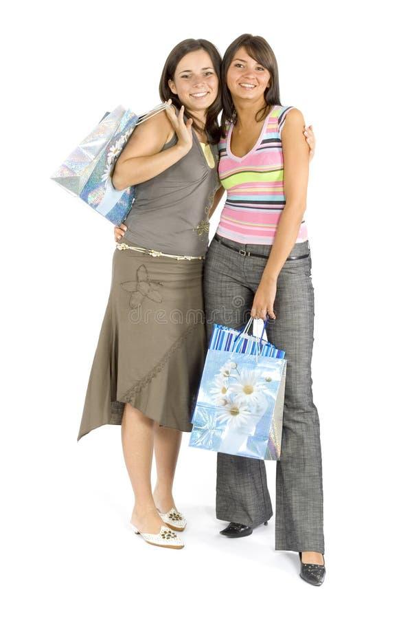 Twee winkelende vrouwen stock afbeeldingen