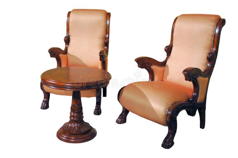 Twee zetels en lijst stock foto's