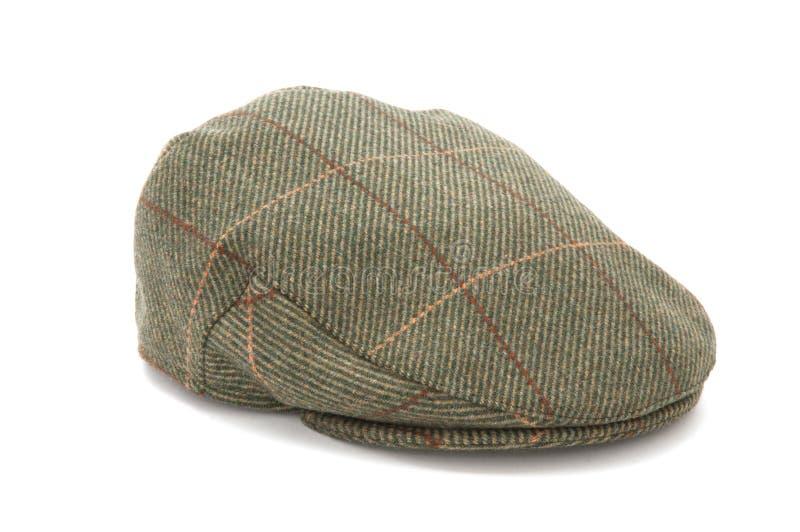 Tweed verde que caza el casquillo plano fotografía de archivo libre de regalías