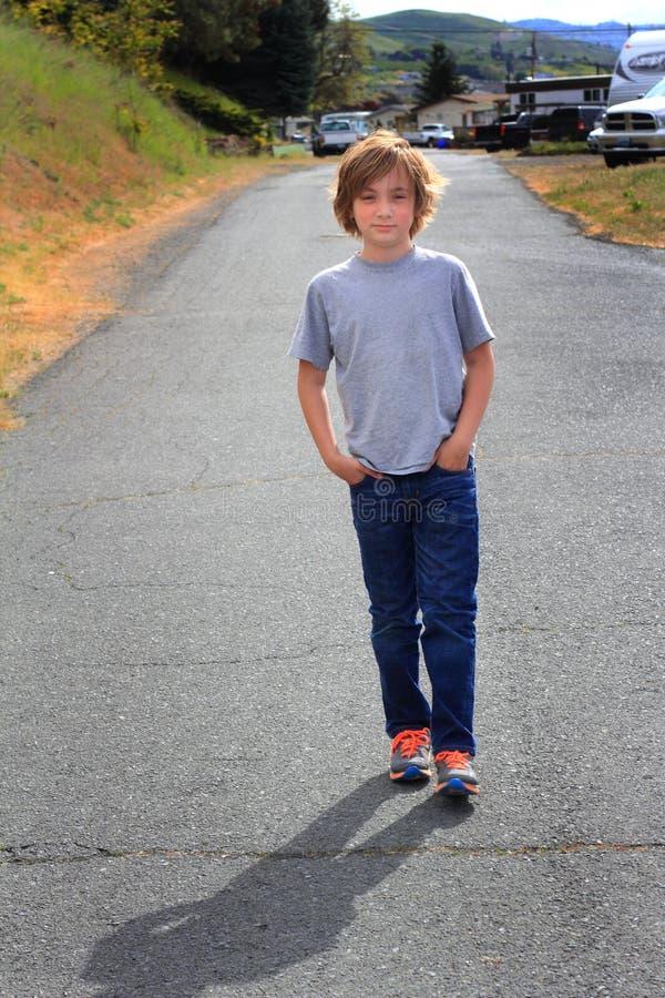 Tween Boy on a Stroll stock photo