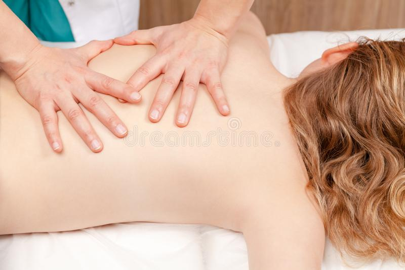 Tween girl receiving osteopathic treatment or medical massage o stock photo