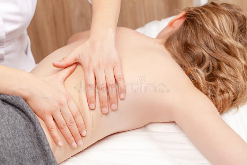 Tween girl receiving osteopathic treatment or medical massage o stock photos