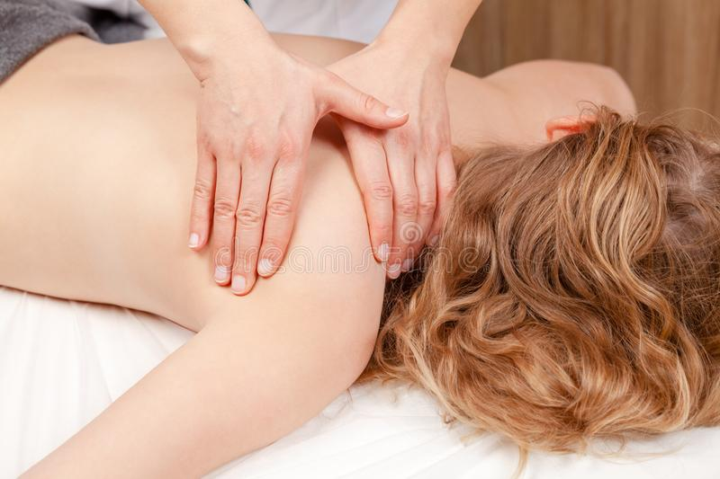 Tween girl receiving osteopathic treatment or medical massage o stock photography