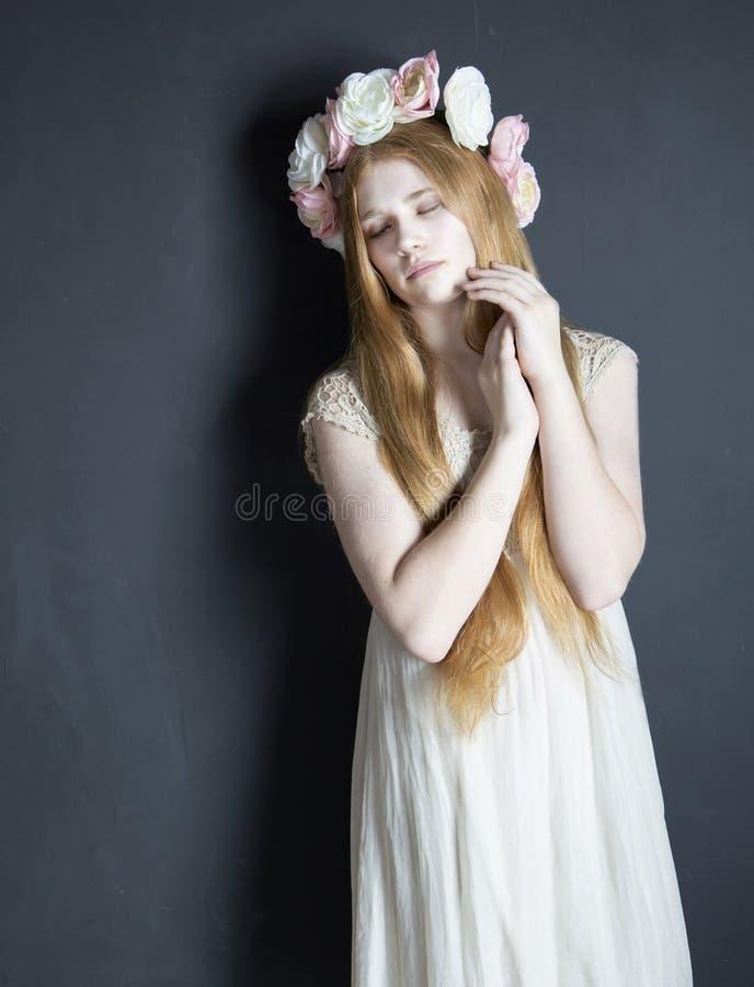 Tween wearing flower crown royalty free stock photo