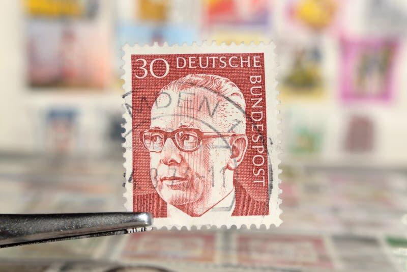 Tweezer holds postage stamp of Germany Federal President Dr. Gustav Heinemann stock photos