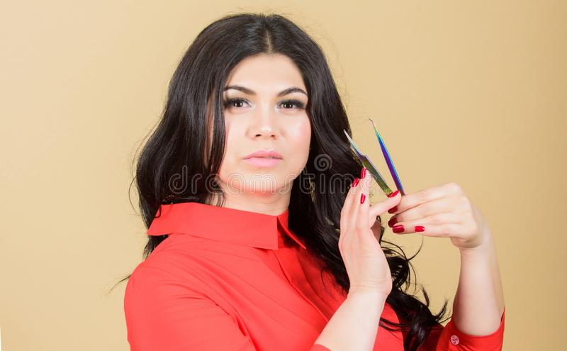 Tweezing eyebrows. professional beautician in beauty salon. Beauty and fashion. Eyelash extension procedure. pretty stock photography