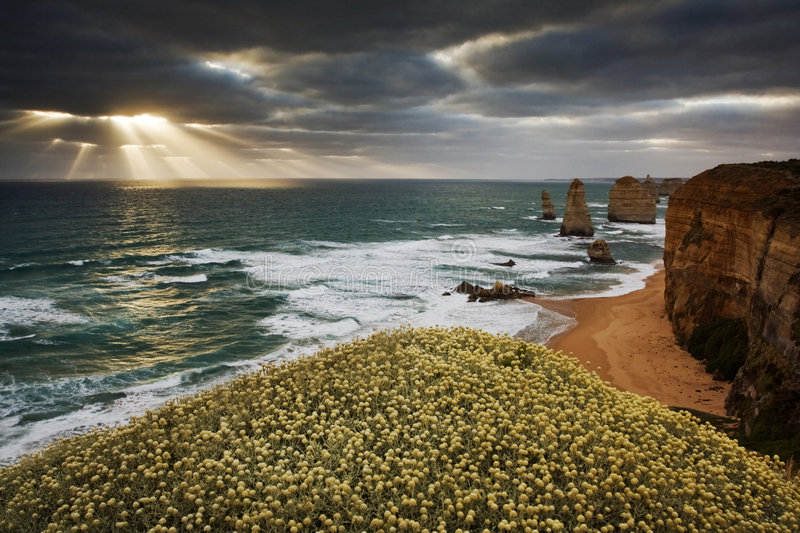 Twelve Apostles. 12 Apostles at Great Ocean Road, Australia. The rays of light are shinning through the clouds stock images
