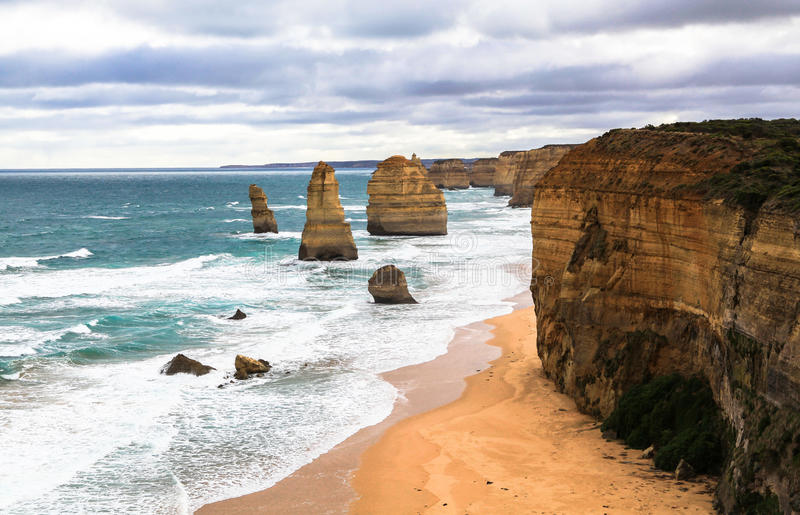 The Twelve Apostles in Australia. This photo was taken in Victoria on April 25th, 2012. The Twelve Apostles is a collection of limestone stacks off the shore of stock photography