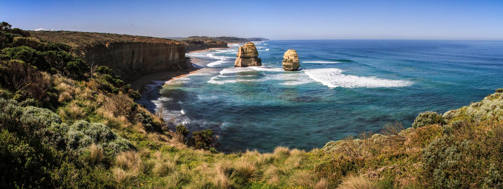 Panoramic on the other side of the Twelve Apostles on a glorious sunny day, great ocean road, victoria, Australia. The Twelve Apostles is a collection of stock photography