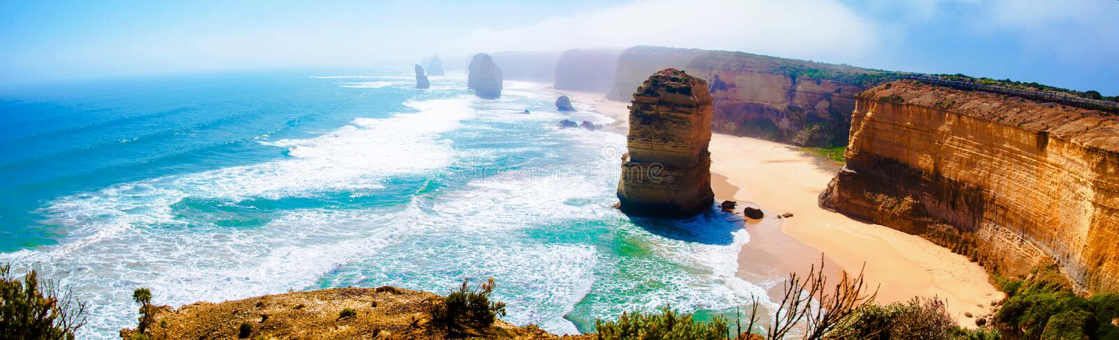 The Twelve Apostles by the Great Ocean Road in Victoria, Australia. The Twelve Apostles, a famous collection of limestone stacks off the shore of the Port stock photo