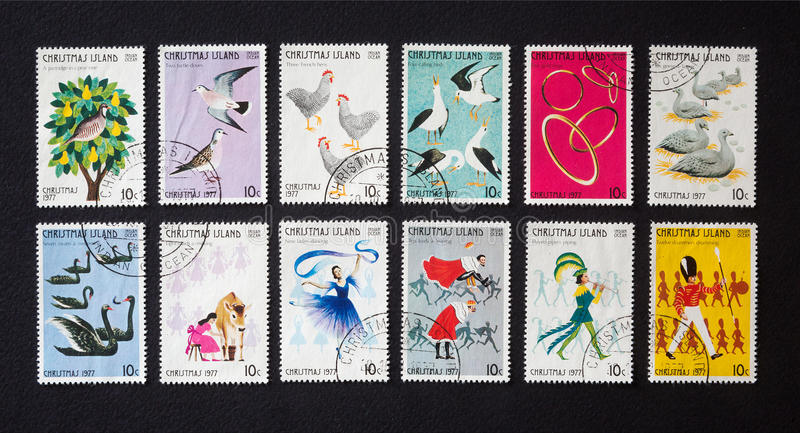 Twelve days of Christmas on postage stamps. The Twelve Days of Christmas is a famous English Christmas carol. Its tales are told a series of postage stamps stock images