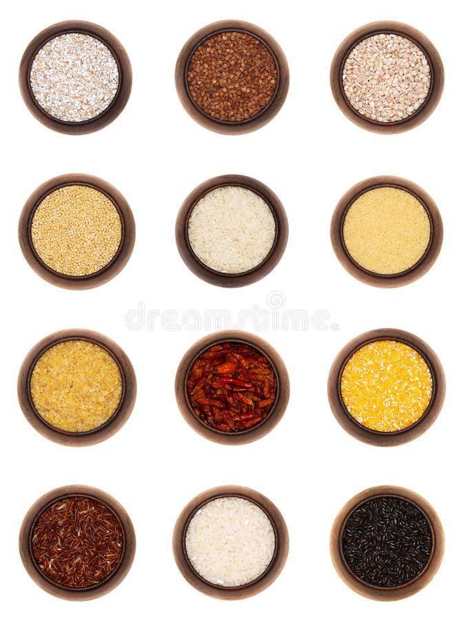 Twelve different cereals in wooden bowls, isolated royalty free stock photography