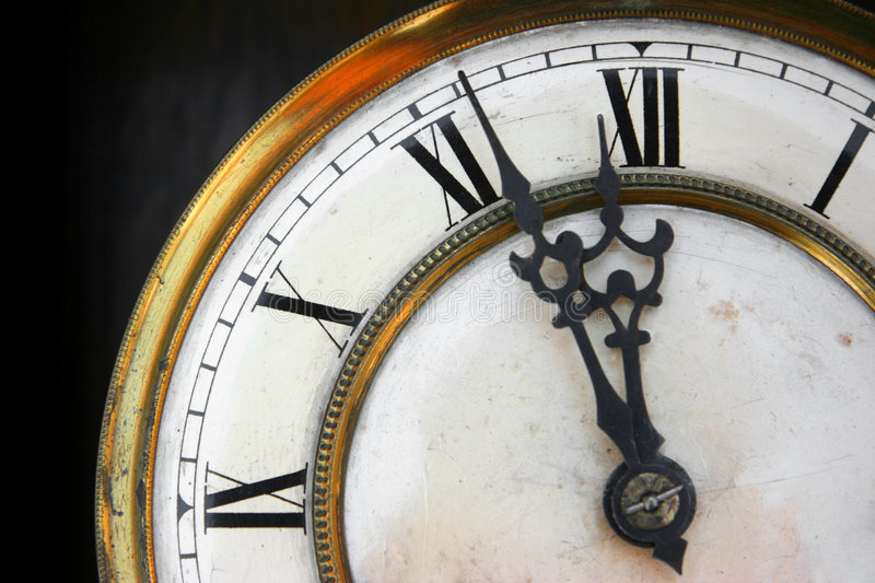 About twelve on old clock face royalty free stock image