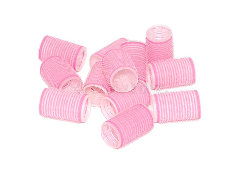 Twelve pink velcro rollers in a pile. Twelve pink velcro rollers in a jumbled pile, isolated on a white background royalty free stock photography