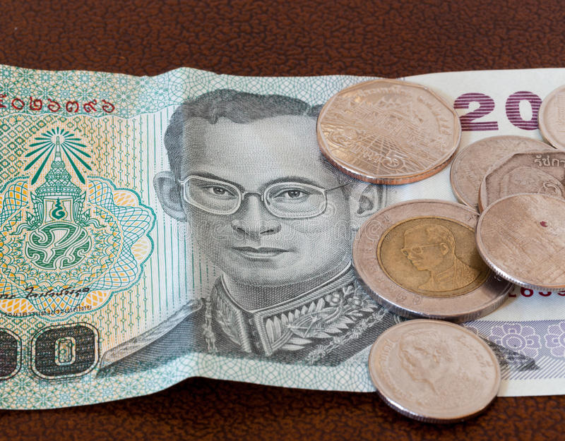 Twenty Baht Note From Thailand With Coins Stock Image