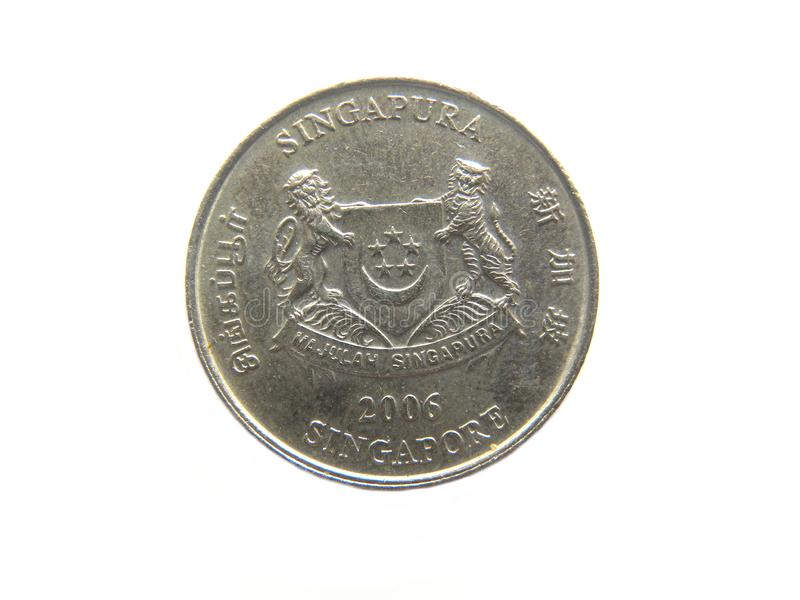 Twenty cents Singapore coin. Obverse of 20 cents Singapore copper and nickel round coin with emblem and Singapore engraved on four sides in English, Tamil royalty free stock photos