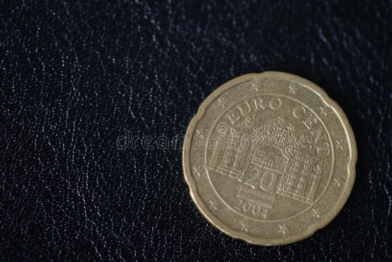Twenty euro cents on a dark background stock photo