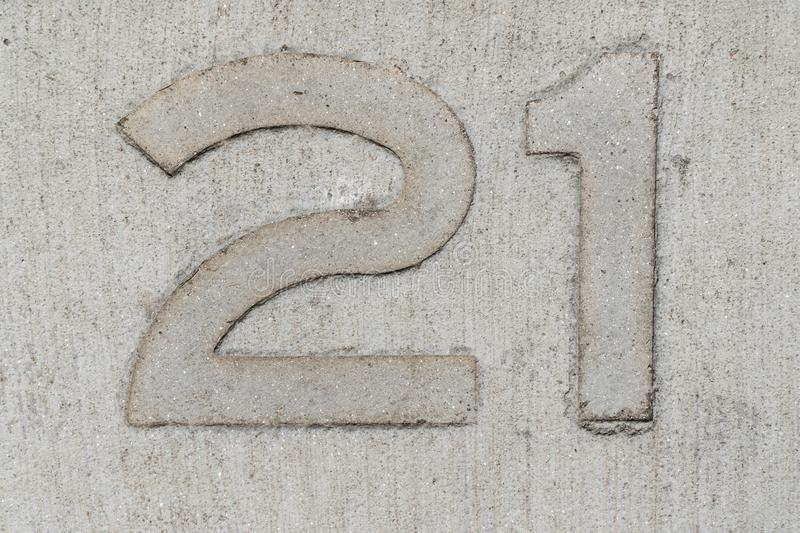 Twenty one number stamped on concrete background stock photography