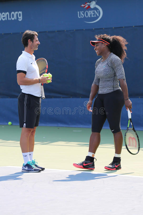 Twenty one times Grand Slam champion Serena Williams practices for US Open 2015 with her coach Patrick Mouratoglou. NEW YORK - AUGUST 30, 2015: Twenty one times royalty free stock images