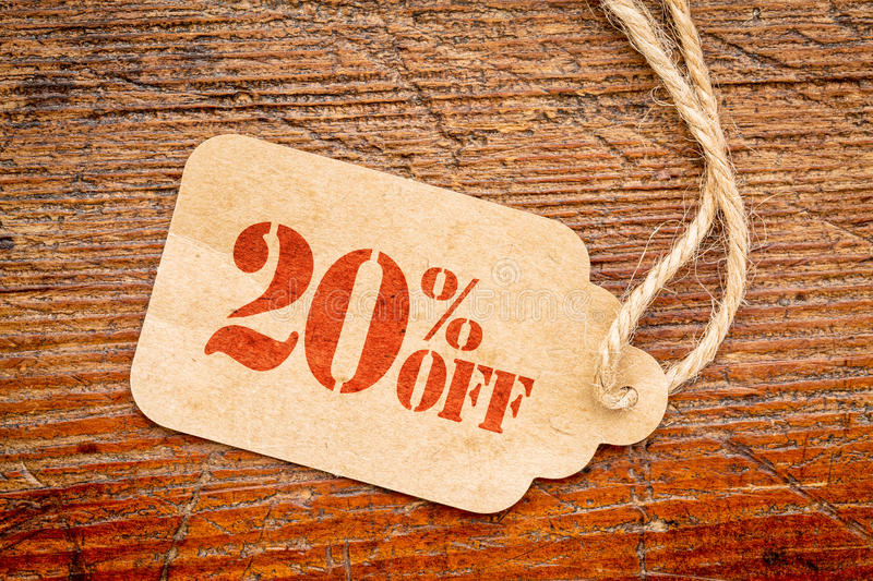Twenty percent off discount - paper price tag. Twenty percent off discount - a paper price tag against rustic red painted barn wood stock photos
