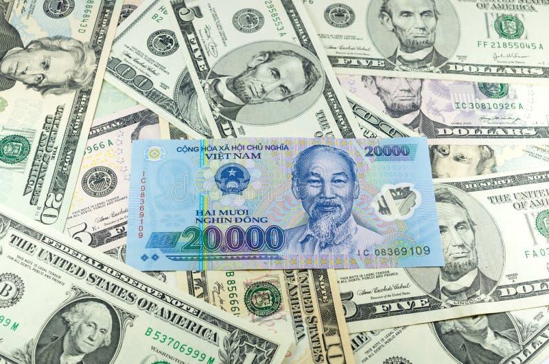 A Vietnamese Ten Thousand Bill With An American One Hundred