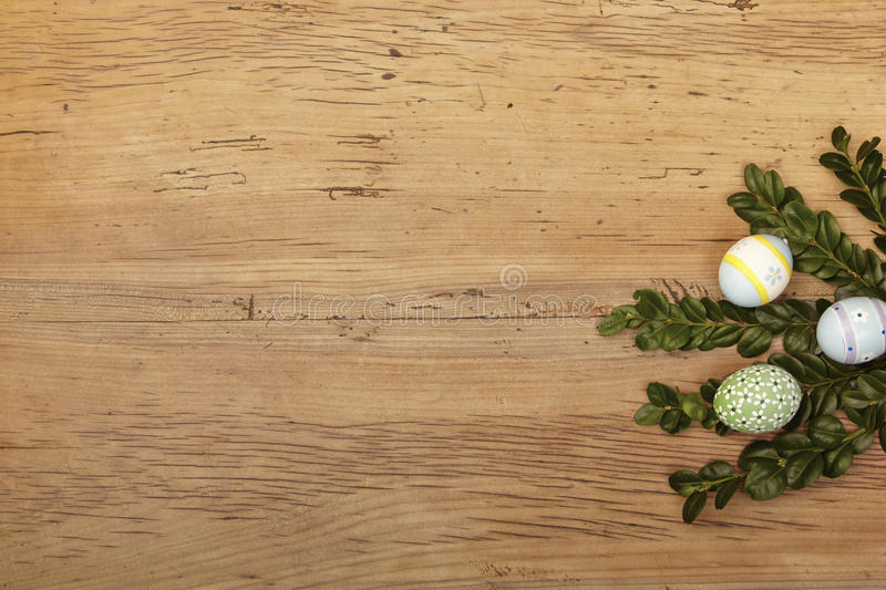 Twigs and easter eggs on wood stock photos