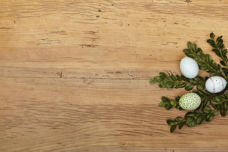 Twigs and easter eggs on wood stock image