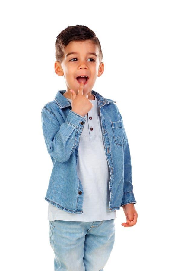 Twijfelachtig kind met denimoverhemd stock afbeeldingen