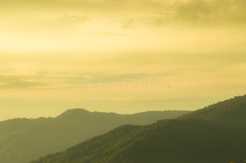 At twilight, Beautiful abstract of mountain, sky and cloud, used as background, natural concept. stock image