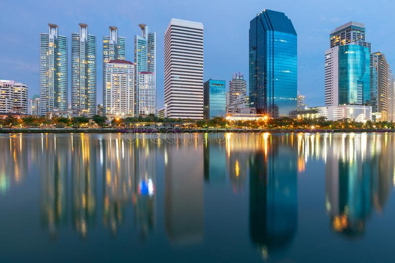 Twilight city building with water reflection stock photography