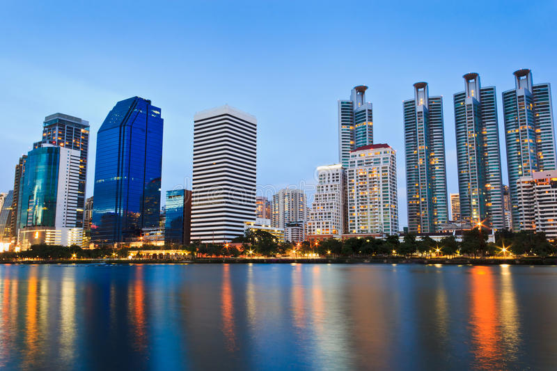 Twilight Cityscape. Office buildings and apartments in Thailand at dusk. View from public park royalty free stock photos
