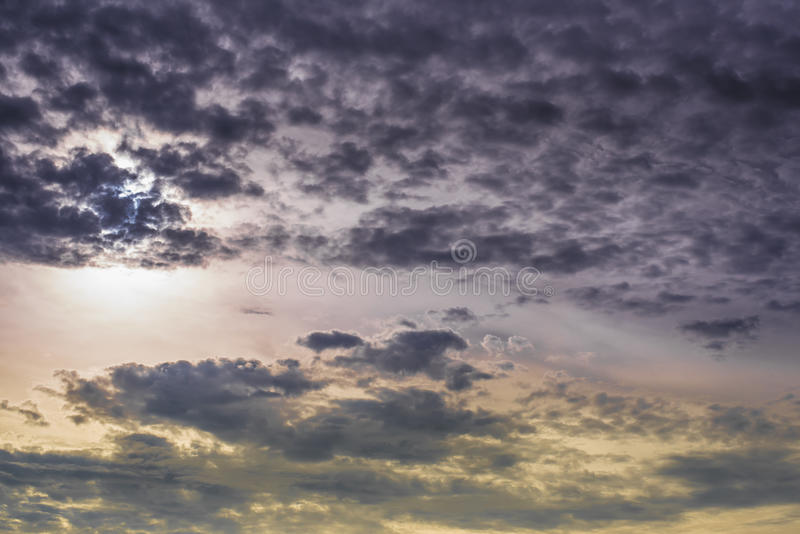 Twilight clouds,Sun stock images