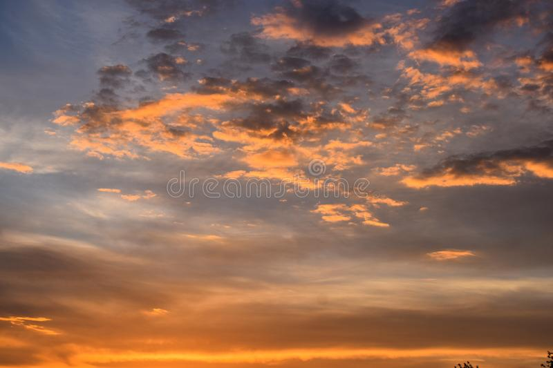 Twilight colorful sky and cloud with sunlight shine behind background. Beautiful sunset with vibrant colors useful or background, stock photography