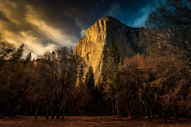 Twilight on El Capitan, Yosemite National Park, California. Taken from a meadow in Yosemite National Park, El Capitan granite cliff is picture here at sunset stock image