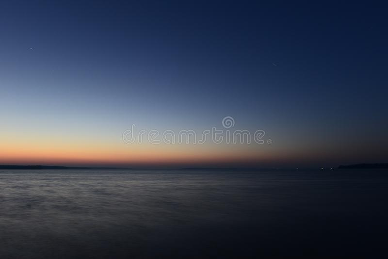 Twilight glow color palette of sunset lines in the dark blue night sky. Dusk landscape Twilight glow color palette of sunset lines in the dark blue night sky royalty free stock photo