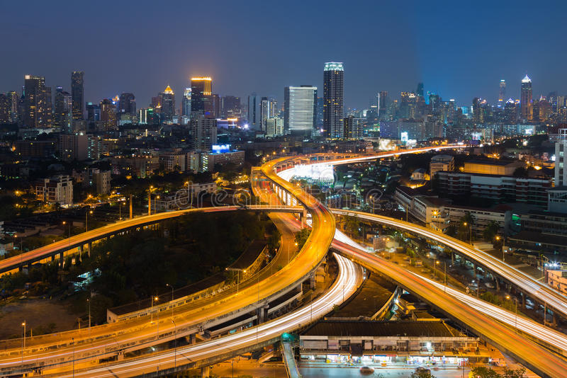 Twilight, highway interchanged infrastructure and city downtown royalty free stock image