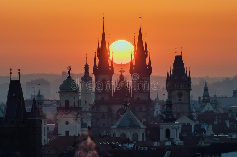 Twilight in historical city. Magical picture of tower with orange sun in Prague, royalty free stock photo