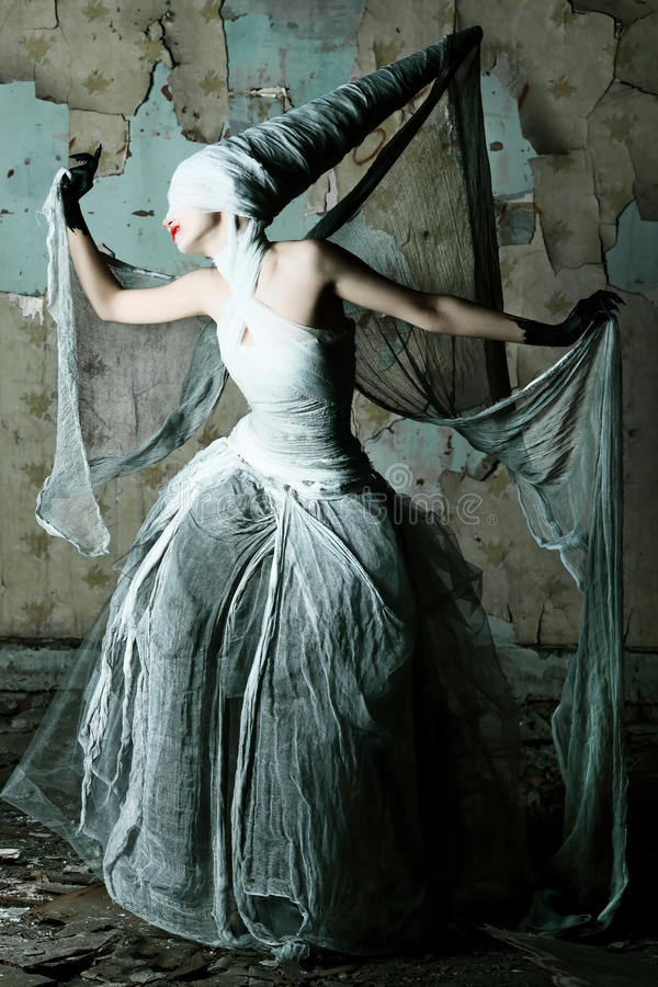 Twilight lady. Shot of a twilight girl in white dress. Halloween, horror royalty free stock photo
