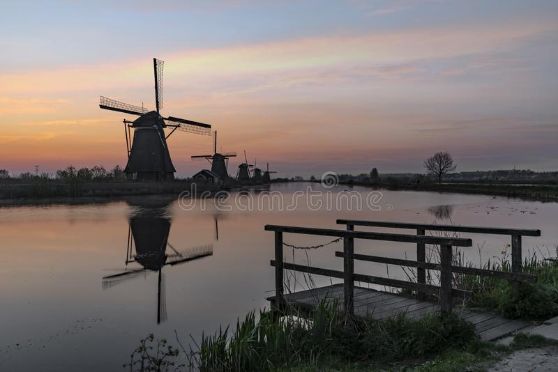 Windmill sunrise silhouette stock photos
